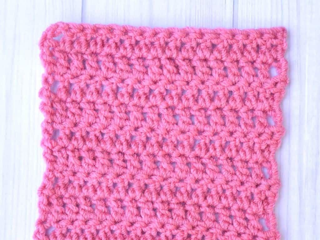 Double crochet swatch made with pink yarn
