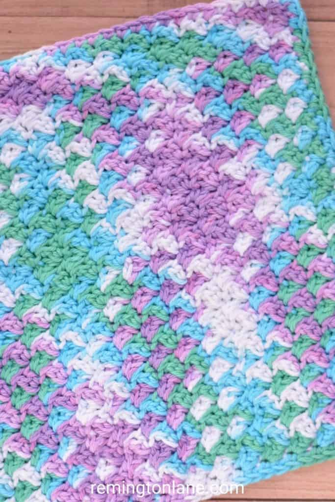 Crochet cotton grit stitch washcloth in Lily Sugar'n Cream beach ball blue colorway