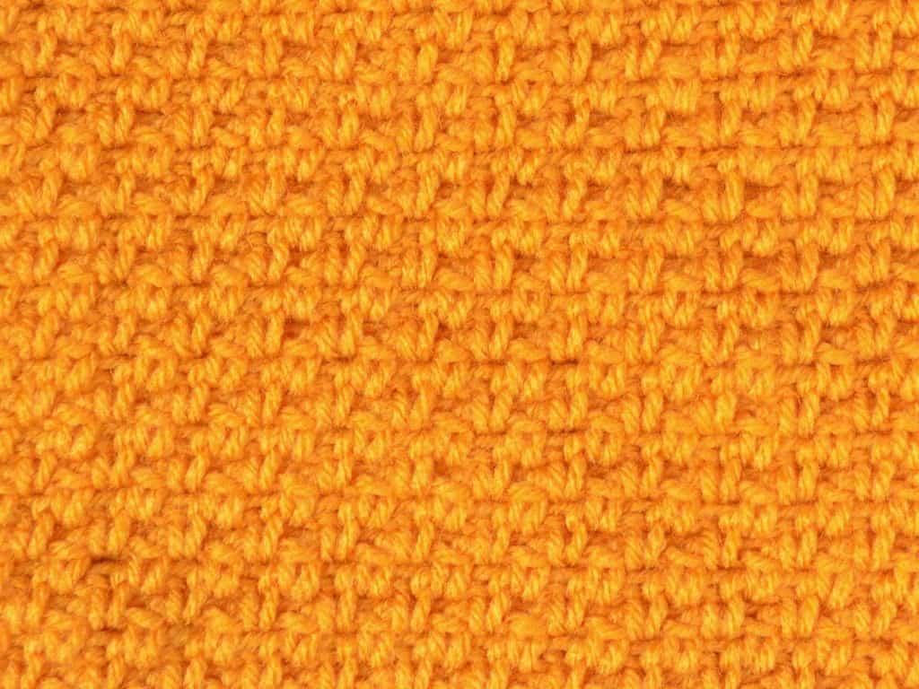 Linen stitch texture in marigold yarn