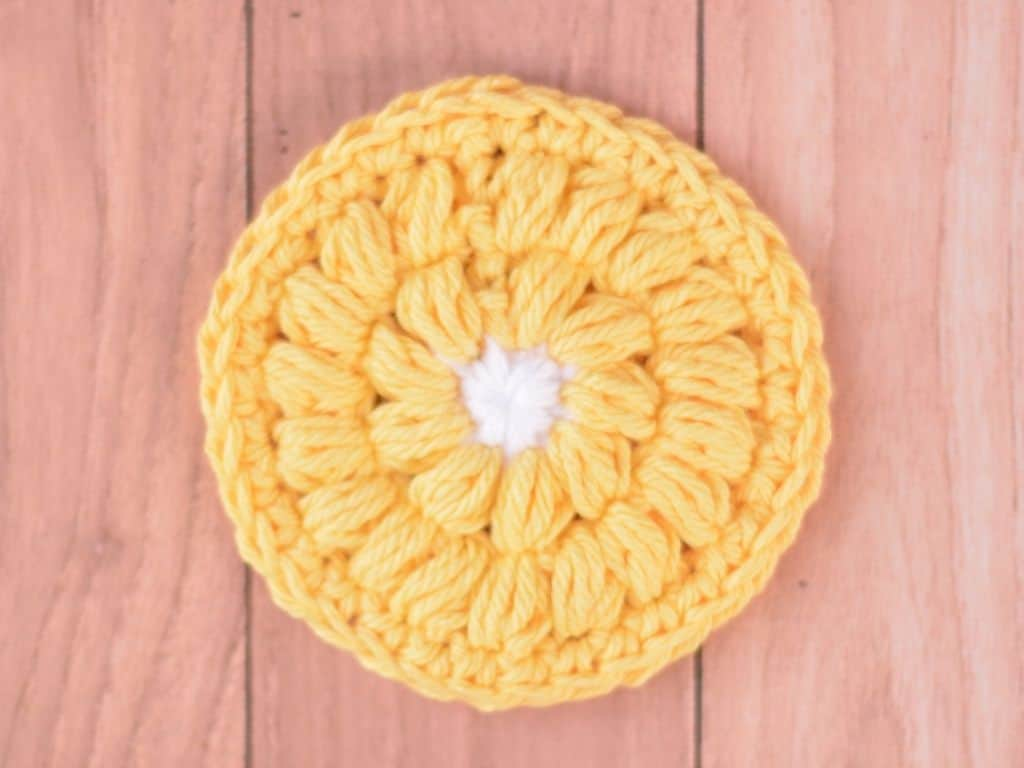 Finished look of the flower version of this crochet face scrubbie pattern