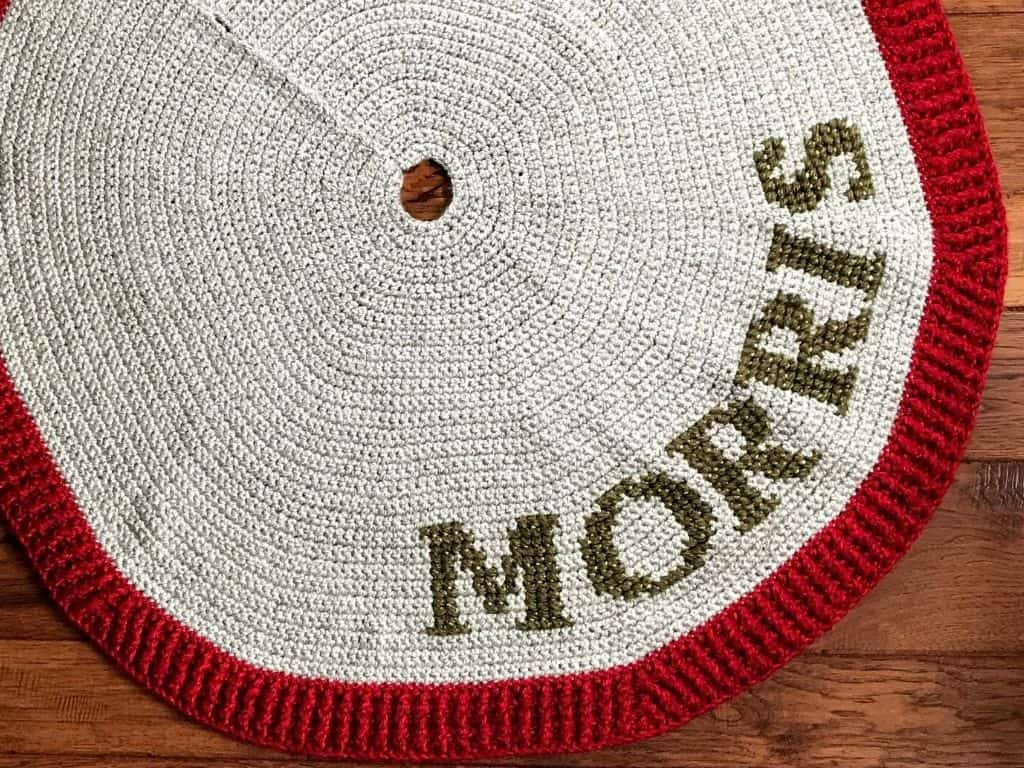 Birds eye view of a crochet tree skirt with monogram lettering in Lion Brand Heartland Thick and Quick yarn