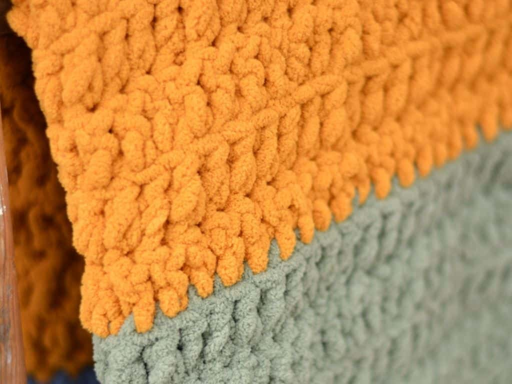Close up of front loop only double crochet stitches in a blanket made with super bulky yarn
