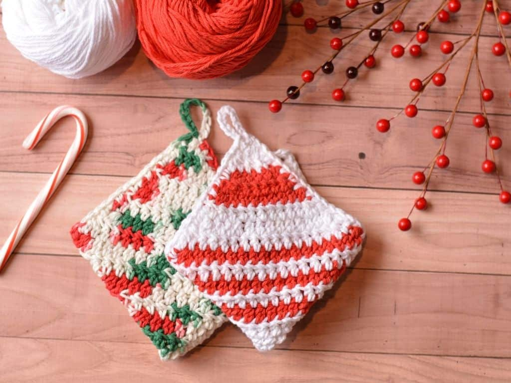 Folded holiday washcloths with red and white stripes, red and green multi-colors