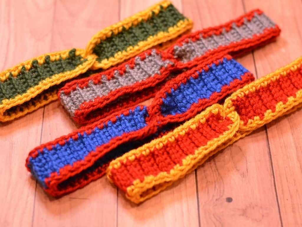 Four crochet headbands in a variety of professional football team colors